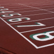 Running tracks with starting numbers — Stock Photo