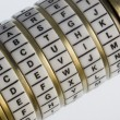 Devil - a password set on a combination puzzle b - Stock Photo