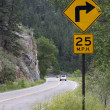 25 mph turning on a mountain road — Foto de Stock