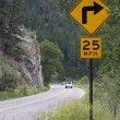 Stock Photo: 25 mph turning on mountain road