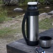 Постер, плакат: Stop and rest when driving car key thermos bo