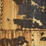rostige Metall Hintergrund mit Nieten — Stockfoto #2433967