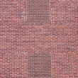 Brick wall with two blind windows — Stock Photo #2434169