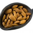 Scoop of shelled almond nuts — Stock Photo