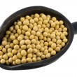 Scoop of yellow soy beans -  