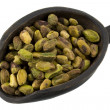 Scoop of raw shelled pistachio nuts — Stock Photo