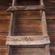 Primitive wooden ladder in old barn — Stock Photo