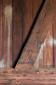 Weathered wooden wall inside an old railroad car — Stock Photo