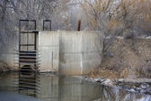 Diversion dam and irrigation ditch — Stock Photo
