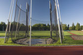 Athletic field with a hammer throw cage and long — Stock Photo