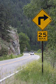 25 mph turning on a mountain road — Stock Photo