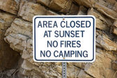 Area closed at sunset - warning sign — Stock Photo