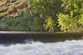 River diversion dam with white water — Stock Photo