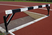 Running tracks with steeplechase barrier — Stock Photo