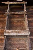 Primitive wooden ladder in old barn — Stock Photo