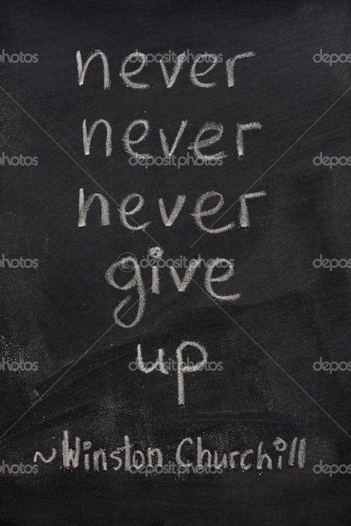 Never give up quote from Winston Churchill handwritten with white chalk  on blackboard — Stock Photo #2435104