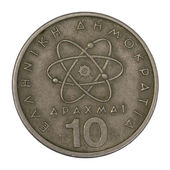 Scientific model of atom on Greek coin — Stock Photo