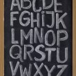 English alphabet on blackboard — Stock Photo