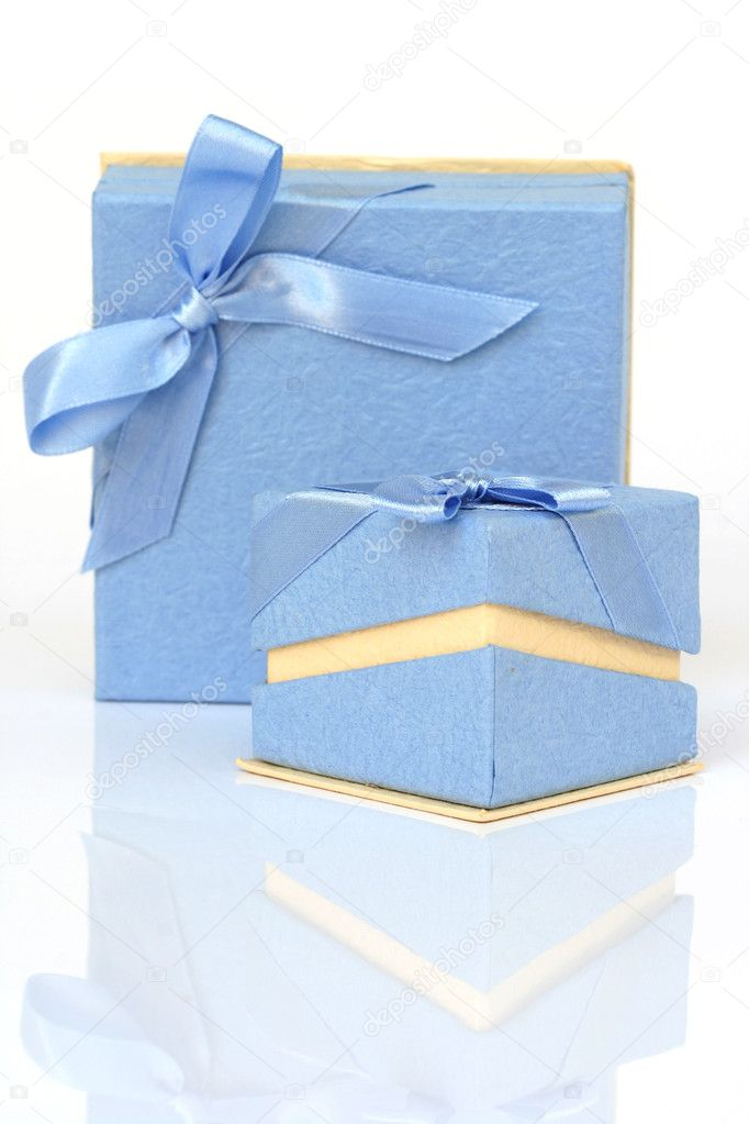 Two cyan gift boxes with reflection isolated on white — Stock Photo #2327200