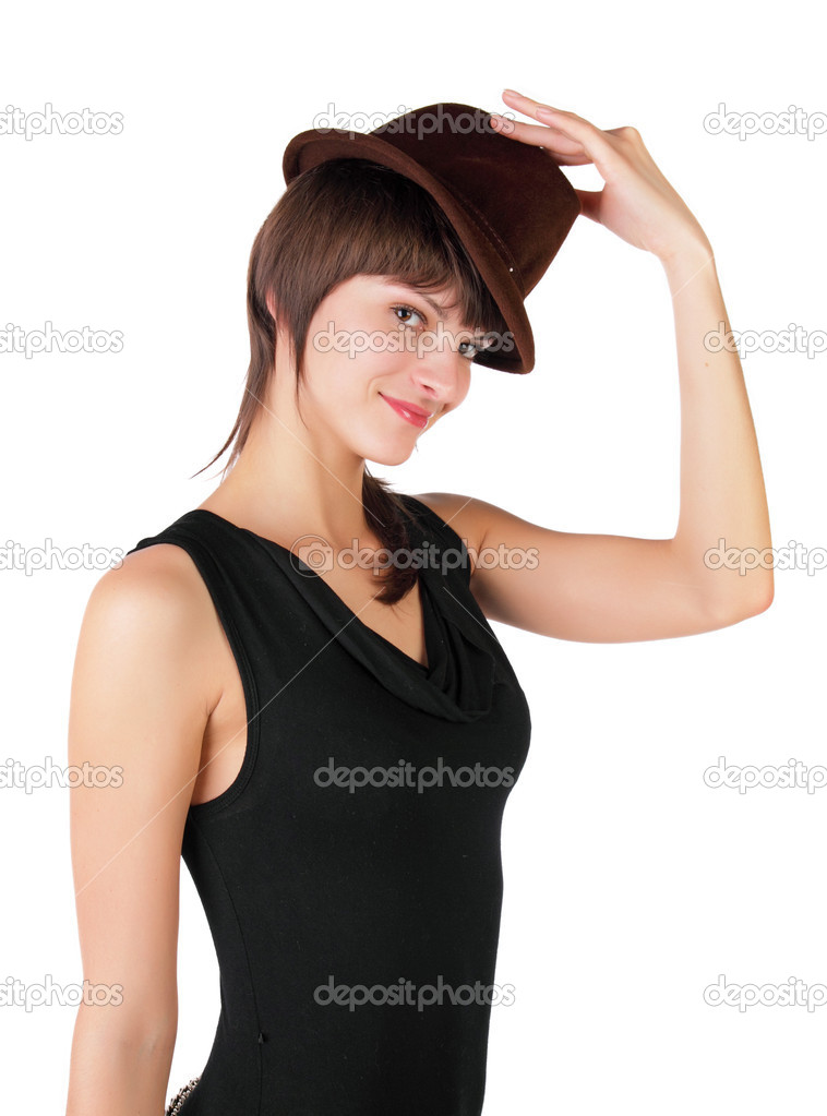 The young girl tries on a hat on a white background — Stock Photo #2053856