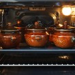 Pots in an oven - Stock Photo