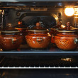 Pots in an oven — Stock Photo