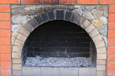 The small brick furnace and soot in it — Stock Photo