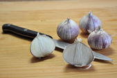 Elephant Garlic on cutting board — Stock Photo