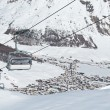 Chairlifts with mountain village — Stockfoto #2398572