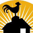 Rooster crowing farm house barn - Stock Photo