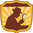 Stock Photo: Detective inspector magnifying glass