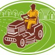 Foto Stock: Male gardener riding lawn mower