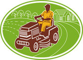 Male gardener riding lawn mower — Stok fotoğraf