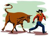 Angry raging bull attacking cowboy — Stock Photo
