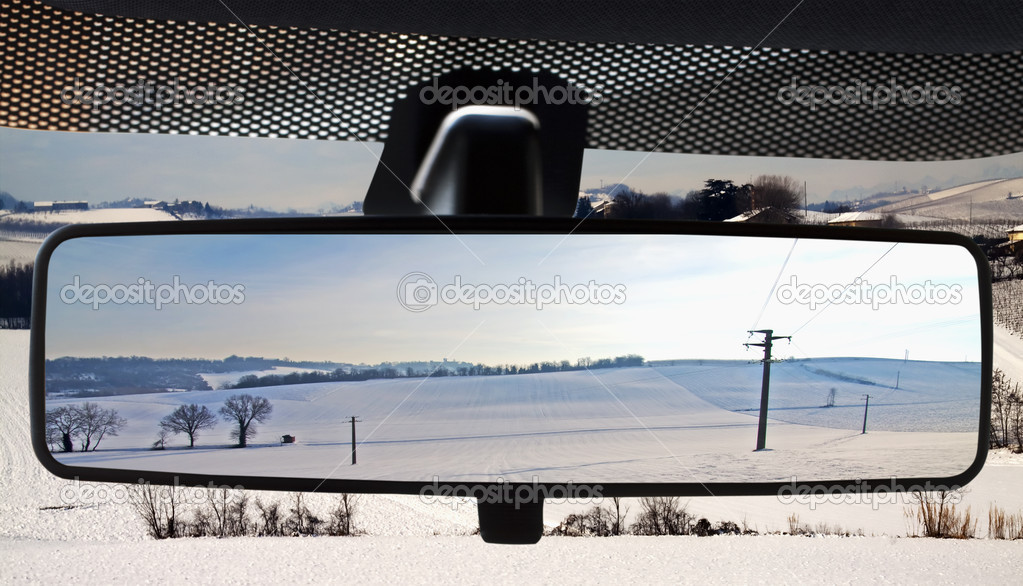 Winter landscape, reflected in the rearviewmirror of a car — Stock Photo #2139371