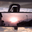 Sunset in the rearviewmirror — Stock Photo
