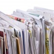 Stock Photo: Vertical pile of newspapers and flyers