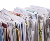 Vertical pile of newspapers and flyers — Stock Photo