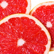 Stock Photo: Pink juicy grapefruit slices