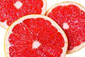 Pink juicy grapefruit slices — Stock Photo