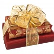 Foto Stock: Two wrapped red gift boxes