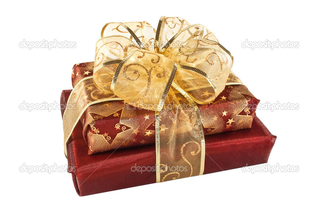 Two wrapped red gift boxes decorated with golden ribbon and bow — Stock Photo #2113098