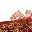 Foto Stock: Shiny red gift box bow