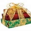 Foto Stock: Wrapped gift boxes with gold ribbon