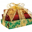 Wrapped gift boxes with gold ribbon - Stock Photo
