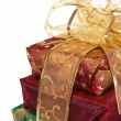 Three wrapped gift boxes with ribbon — Foto Stock