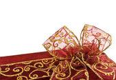 Shiny red gift box bow — Stock Photo