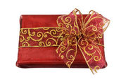 Red wrapped gift box with a bow — Stock Photo