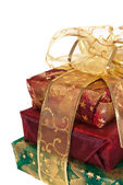 Three wrapped gift boxes with ribbon — Stock Photo