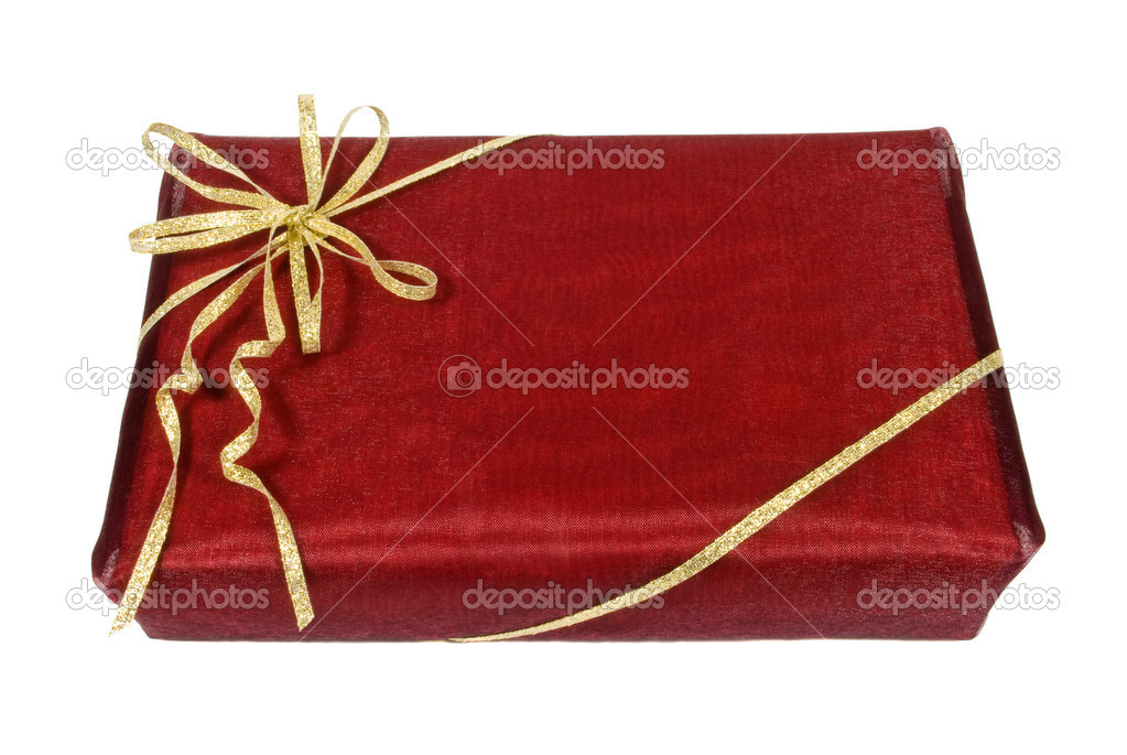 Wrapped dark red gift box with golden ribbon, clipping path — Photo #2486806